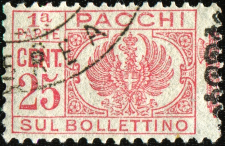 affixed: ITALY - CIRCA 1930: Postage stamps for packets and parcels. Was released in Italy on Dec. 22, 1930 and used until 31 December 1948. This photo shows half affixed to the parcel.