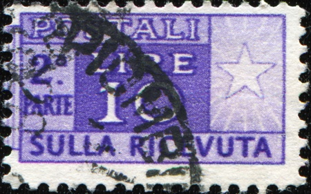 affixed: ITALY - CIRCA 1946:  Postage stamps for packets and parcels. Was released in Italy on 1946. This photo shows half affixed to the receipt. Circa 1946