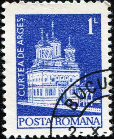 ROMANIA - CIRCA 1967: A stamp printed in Romania shows Curtea de Arges church, circa 1967 Stock Photo - 8776563