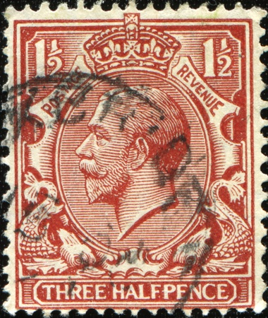 UNITED KINGDOM - CIRCA 1912 to 1924: An English Used Three Halfpence Brown Postage Stamp showing Portrait of King George V, circa 1912 to 1924  Stock Photo - 8776578