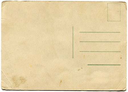 yellowed: back side of an antique post card isolated on white  Stock Photo