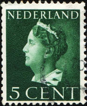wilhelmina: NETHERLANDS - CIRCA 1947: A stamp printed in the Netherlands shows Queen Wilhelmina, series, circa 1947