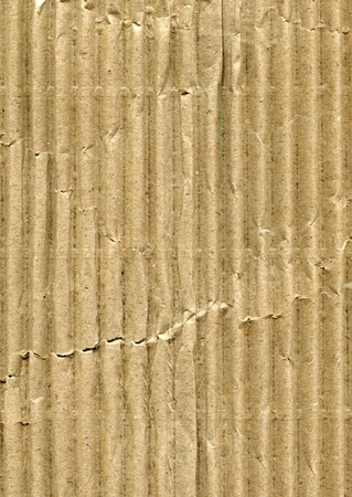 certain: A corrugated cardboard texture with creases and wrinkles in certain spots