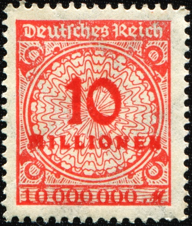 GERMANY - CIRCA 1932: A stamp printed in the Federal Republic of Germany shows image of hyper inflated numbers, series, circa 1932  photo