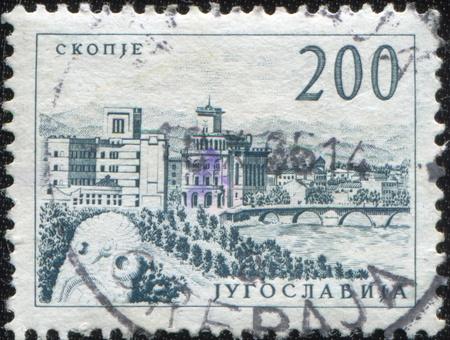 YUGOSLAVIA - CIRCA 1950s: A stamp printed in Yugoslavia shows City of Skopje, circa 1950s  photo
