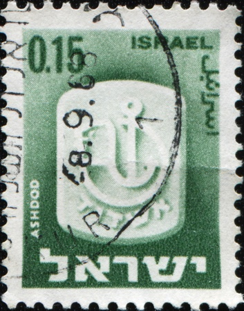 ashdod: ISRAEL - CIRCA 1965: A stamp printed in Israel shows coat of arms of city Ashdod, circa 1965