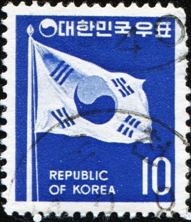 SOUTH KOREA - CIRCA 2003: A stamp printed in South Korea shows Taegukki Seven Won denomination depicts Taegukki (Korean national flag) which symbolizes the Republic of Korea, circa 2003 photo