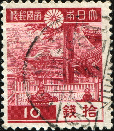 cancelled stamp: JAPAN - CIRCA 1938: A post stamp printed in Japan  shows Torii  Ememon to Tosho-gu in Nikko, circa 1938 Stock Photo