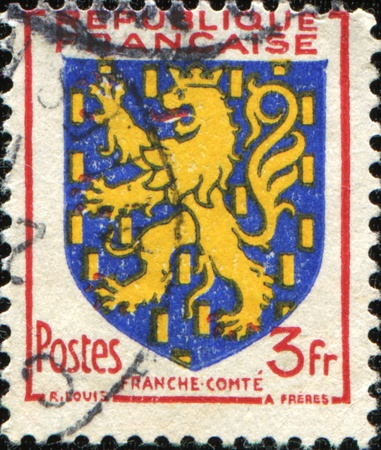 FRANCE - CIRCA 1951: A stamp printed in France shows coat of arms of Franch Comte, circa 1951 photo