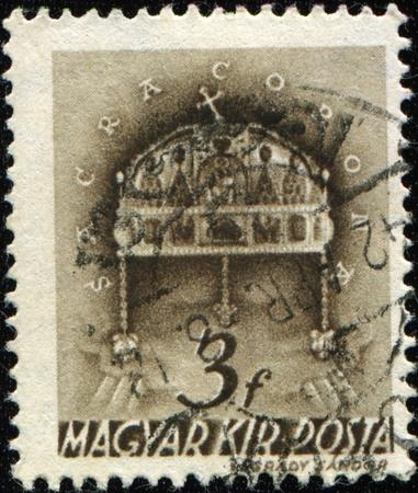 sacra: HUNGARY - CIRCA 1942: A stamp printed in Hungary shows symbols of royal power in Hungary - Sacra Corona, circa 1942