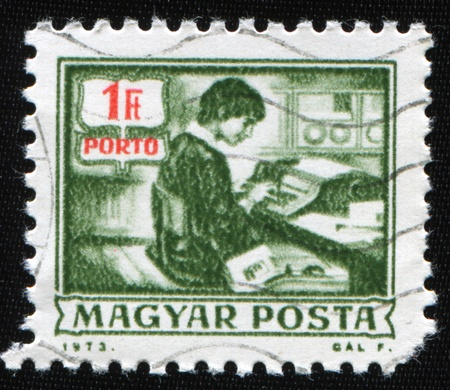 HUNGARY - CIRCA 1973: A stamp printed in Hungary shows telegrapher, circa 1973 photo