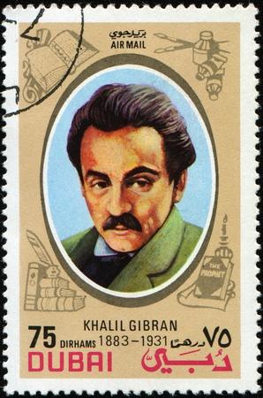 DUBAI - CIRCA 1972: A stamp printed in Dubai shows Khalil Gibran - Lebanese American artist, poet, and writer, circa 1972 Foto de archivo
