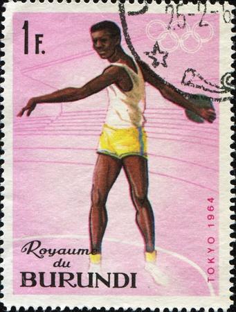 BURUNDI - CIRCA 1964: A stamp printed in Burundi shows discus thrower, circa 1964