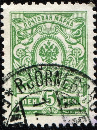 royal mail: RUSSIAN EMPIRE - CIRCA 1884: A stamp printed in Russia shows Emblem of the Royal Family of Russia, circa 1884