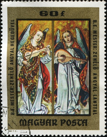 lute: HUNGARY - CIRCA 1973: A stamp printed in Hungary shows angels who play violin and lute, circa 1973