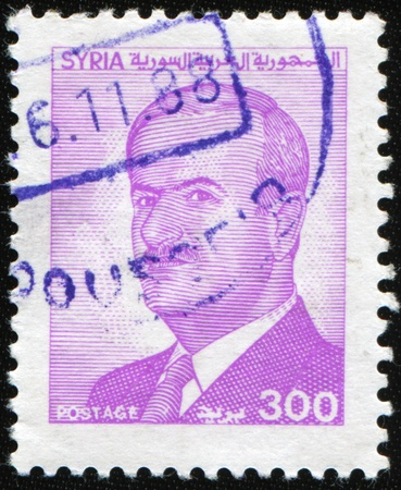 hafez: SYRIA - CIRCA 1988: A stamp prunted in Syria shows president Hafez al-Assad Editorial