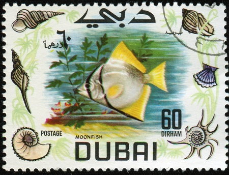DUBAI - CIRCA 1969: A stamp printed in Dubai shows moonfish, circa 1969 photo
