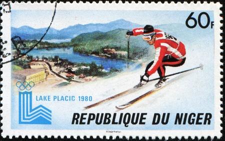 NIGER - CIRCA 1980: A stamp printed in Republic Niger shows mountain-skier, circa 1972