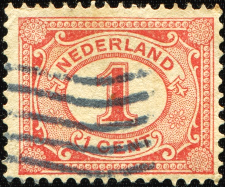 NETHERLANDS - CIRCA 1898: Netherlands Stamp Numeral 1 Cent, circa 1898  photo
