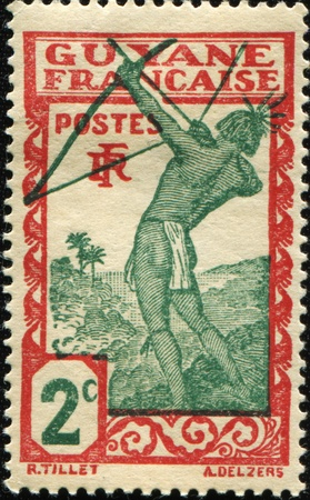 FRENCH GUIANA - CIRCA 1929: A stamp printed in French Guiana show Caribean archer, circa 1929 photo