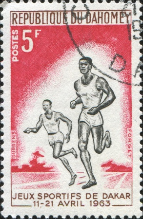 DAHOMEY - CIRCA 1963: A stamp printed in Republic of Dahomey show two black runners, circa 1963 photo