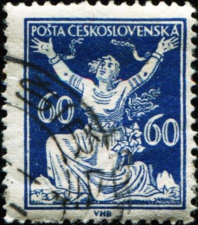 CZECHOSLOVAKIA - CIRCA 1920: stamp printed in Czechoslovakia shows chainbreaker, Series, circa 1920  photo