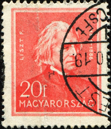 liszt: HUNGARY - CIRCA 1932: A post stamp printed in Hungary shows composer Franz Liszt, circa 1932