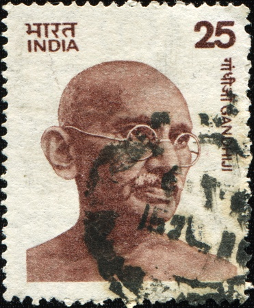 nonviolence: INDIA - CIRCA 1976: Mohandas Karamchand Gandhi was the pre-eminent political and spiritual leader of India during the Indian independence movement, circa 1976