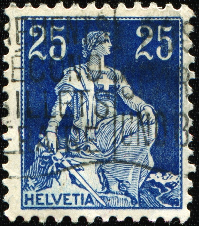 personification: SWITZERLAND - CIRCA 1922: A stamp printed in Switzerland shows Helvetia is the female national personification of Switzerland, circa 1922