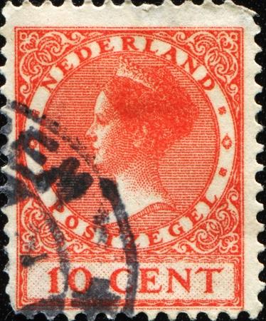 wilhelmina: NETHERLANDS - CIRCA 1919: A stamp printed in Netherlands shows Wilhelmina of the Netherlands, circa 1919