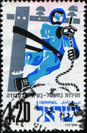 ISRAEL - CIRCA 1975: A stamp Caution with electricity - safety at work printed in Israel, circa 1975 photo