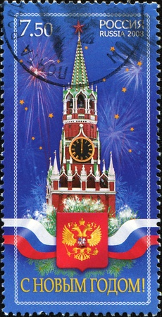 spassky: RUSSIA - CIRCA 2008: A greentin Christmas stamp printed in Russia shows Spassky Tower of Moscow Kremlin and the Russian coat of arms, circa 2008