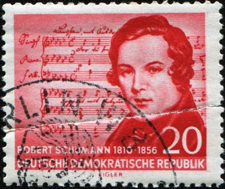influential: GERMAN DEMOCRATIC REPUBLIC - CIRCA 1956: A  stamp printed in GDR shows Robert Schumann was a German composer, aesthete and influential music critic, circa 1956