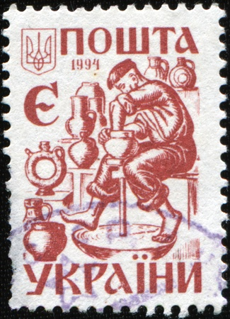 UKRAINE - CIRCA 1994: A stamp printed in Ukraine shows potter, circa 1994 Stock Photo - 9065821