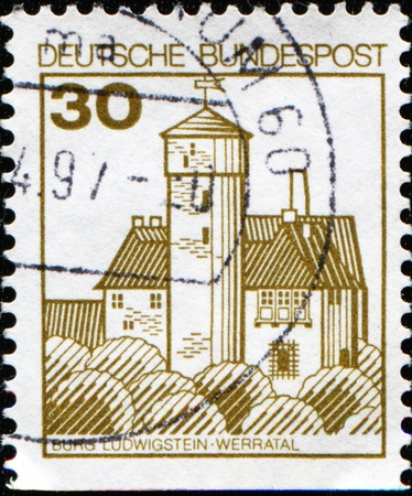 beautiful woodland: GERMANY - CIRCA 1977: A stamp printed in Germany shows Burg Ludwigstein is a 15th-century castle overlooking the river Werra and surrounded by beautiful woodland, circa 1977  Stock Photo