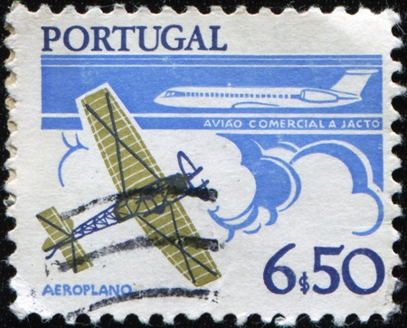 avia: PORTUGAL - CIRCA 1978: A stamp printed in Portugal shows Monoplane and B.A.C. One Eleven airliner , circa 1978 Stock Photo