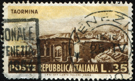 ITALY - CIRCA 1953: A stamp printed in Italy shows Italia ruins of antique theatre in Taormina, series, circa 1953 Stock Photo - 9065918