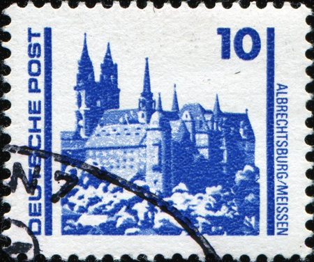 GERMAN DEMOCRATIC REPUBLIC - CIRCA 1990: A stamp printed in GDR (East Germany) shows cathedral in Albrechsburg in Meissen, circa 1990 Stock Photo - 9065923