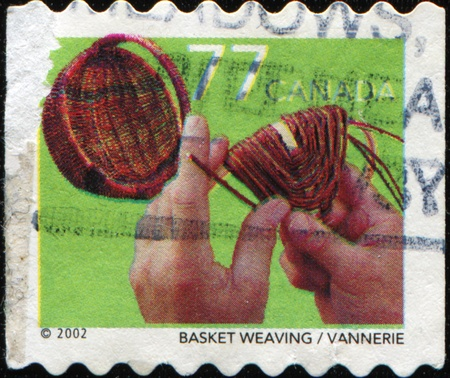 basket weaving: CANADA - CIRCA 2002: A stamp printed in Canada shows Basket weaving, circa 2002 Stock Photo