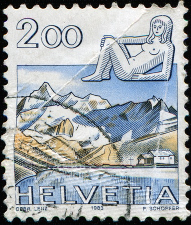 helvetica: SWITZERLAND - CIRCA 1983: A stamp printed Switzerland, officially Confideratio Helvetica, shows Zodiac sign Virgo  on the background  of Schwarzsee view, circa 1983 Stock Photo