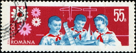 pioneers: ROMANIA - CIRCA 1968: A stamp printed in Romania shows Pioneers - model aircraft and ship builders, circa 1968  Stock Photo