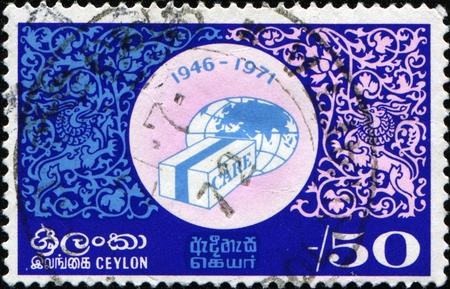 co operative: CEYLON - CIRCA 1971: A stamp printed in Ceylon honoring 25th Anniversary of Co-operative for American Relief Everywhere, shows Globe and CARE Package, circa 1971