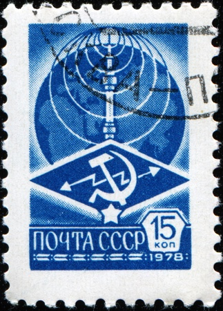 USSR - CIRCA 1976: A stamp printed in USSR shows Ostankino television tower and the logo of Ministry of Communications on the background of the Globe, circa 1976 Stock Photo - 9180237
