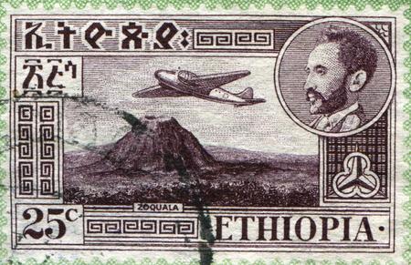 ETHIOPIA - CIRCA 1947: A stamp printed in Ethiopia shows Views with medallion portrait of Haile Selassie inset, Douglas DC-3 over Zoquala Volcano, circa 1947 Stock Photo - 9180307
