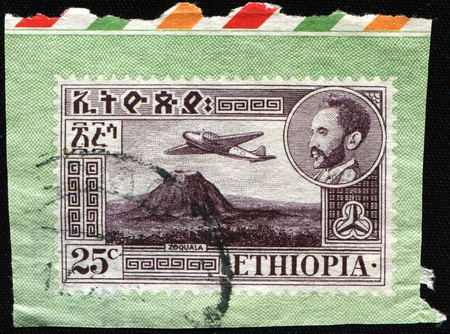 haile: ETHIOPIA - CIRCA 1947: A stamp printed in Ethiopia shows Views with medallion portrait of Haile Selassie inset, Douglas DC-3 over Zoquala Volcano, circa 1947 Stock Photo