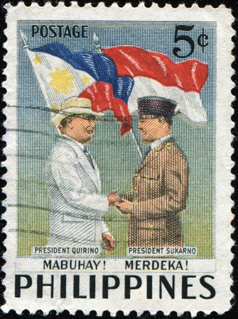 sukarno: PHILIPPINES - CIRCA 1953: A stamp printed in Philippines honoring Visit of President to Indonesia shows Presidents Quirino and Sukarno, circa 1953 Editorial