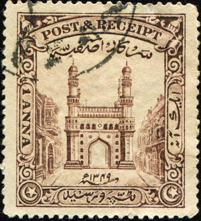 andhra: INDIA - CIRCA 1934: A stamp printed in Hyderabad shows Charminar, the literal translation - The Mosque  of Four Minarets or Four Towers, Andhra Pradesh, circa 1934