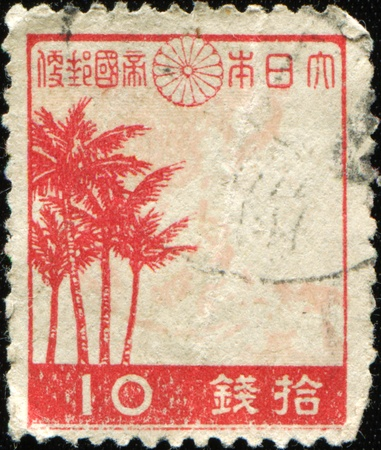 JAPAN - CIRCA 1942: A stamp printed in Japan shows Palms and map of Greater East Asia, circa 1942 Stock Photo - 9180310
