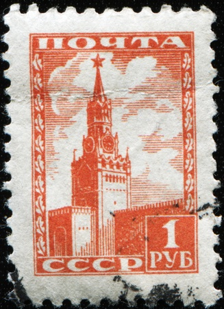 USSR - CIRCA 1941: A Stamp printed in the USSR shows the Spassky tower of the Moscow Kremlin, circa 1941 Stock Photo - 9180309