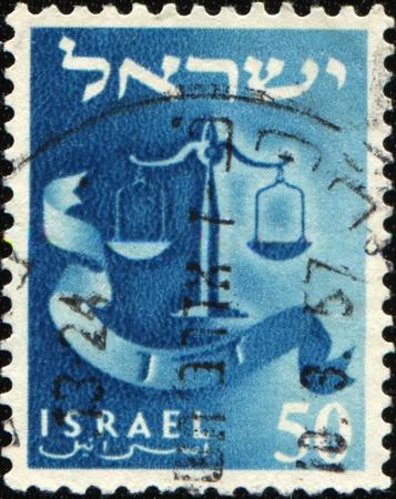 ISRAEL - CIRCA 1955: A stamp prined in Israel honoring Twelve Tribes of Israel shows Dan - scales, circa 1955 Stock Photo - 9180306
